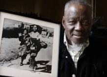 Sam Nzima with his iconic shot of Soweto Uprising